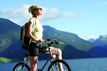 attractive woman on the bike in the mountains